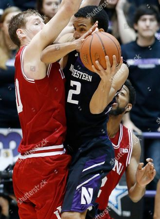Jared Swopshire, Cody Zeller, Christian Watford Northwestern forward Jared Swopshire (12) looks to a pass as Indiana forward Cody Zeller, left, and forward Christian Watford guard during the first half of an NCAA college basketball game in Evanston, Ill