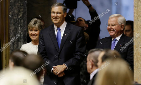 Stock Picture of Jay Inslee Gov. Jay Inslee, second from left, is escorted by Sen. Linda Evans Parlette, R-Wenatchee, left, and Rep. Sam Hunt, D-Olympia, right, as he pauses at the entrance to the House chamber, to speak to a joint session of the Washington Legislature shortly after he was sworn in as Governor, at the Capitol in Olympia, Wash