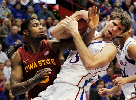 Jeff Withey, Melvin Ejim Kansas center Jeff Withey (5) battles for a rebound with Iowa State forward Melvin Ejim (3) during the second half of an NCAA college basketball game in Lawrence, Kan., . Kansas won 97-89 in overtime