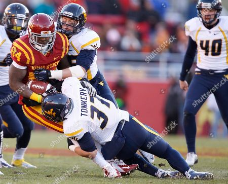 Ernst Brun Jr., Nick Kwiatkoski, Wes Tonkery Iowa State tight end Ernst Brun Jr., left, runs the ball as West Virginia linebacker's Nick Kwiatkoski, third from top left, and Wes Tonkery (37) make the tackle during the first half of an NCAA college football game, in Ames, Iowa