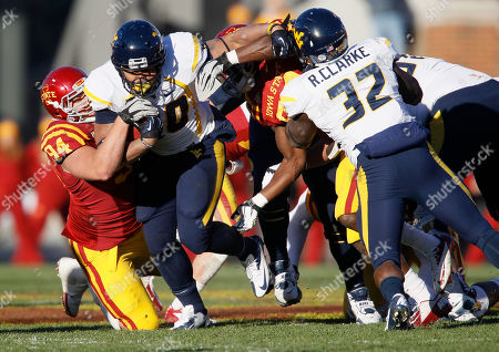 Stock Photo of Jake McDonough, Shawne Alston Iowa State defensive lineman Jake McDonough, left, tackles West Virginia running back Shawne Alston, center, during the first half of an NCAA college football game, in Ames, Iowa