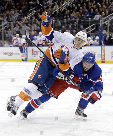 David Ullstrom, Steve Eminger New York Islanders' David Ullstrom, left, leans on New York Rangers' Steve Eminger during the first period of the NHL hockey game in New York