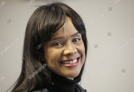 """Sandi Jackson Chicago Alderman Sandi Jackson, wife of former U.S. Rep. Jesse Jackson Jr., smiles at her Chicago office. Alderman Sandi Jackson on announced she is resigning from the Chicago City Council. In a letter to Mayor Rahm Emanuel, she said that she could not adequately represent her district """"while dealing with very painful family health matters."""" Rep. Jackson recently resigned from Congress while being treated for bipolar disorder and other medical issues"""