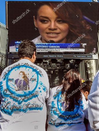 Stock Image of Rosa Rivera Flores Fans of the late singer Jenni Rivera watch a live broadcast of her memorial service at Universal City in Los Angeles. Rivera, a Mexican-American singer and reality TV star, was killed in a Dec. 9 plane crash