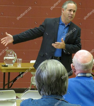 "Tim Huelskamp Kansas Congressman Tim Huelskamp discusses his opposition to legislation averting the federal government's so-called ""fiscal cliff"" and other federal issues during a town hall meeting, in Emporia, Kan. The conservative Republican congressman has been at odds with even the U.S. House's GOP leaders, and it's cost him key committee assignments"