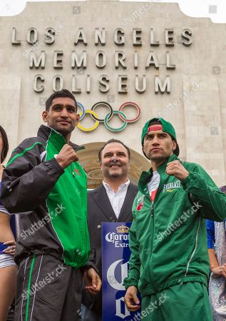 "Amir Khan, Richard Schaefer, Carlos Molina British boxer Amir ""King"" Khan, left, and opponent Carlos Molina, right, pose for a photo during the weigh-in ceremony for their super lightweight bout at the Los Angeles Memorial Coliseum. The pair face off against each other on Saturday. Richard Schaefer, CEO of Golden Boy Promotions, center"