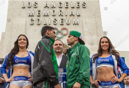 """Amir Khan, Richard Schaefer, Carlos Molina British boxer Amir """"King"""" Khan, left, and opponent Carlos Molina, right, pose for a photo during the weigh-in ceremony for their super lightweight bout at the Los Angeles Memorial Coliseum . The pair face off against each other on Saturday. Richard Schaefer, CEO of Golden Boy Promotions, center"""