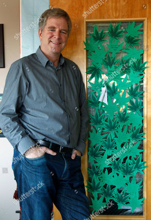 "Stock Photo of Rick Steves Travel guide author and marijuana legalization supporter Rick Steves stands in his office in Edmonds, Wash next to a door covered with marijuana leaf-shaped notes from his staff congratulating him on the passage of a referendum legalizing marijuana in the state. Known for his public television and radio shows, as well as his ""Europe through the Back Door"" guide books, he openly advocated in 2003 for a measure that made marijuana the lowest priority for Seattle police"