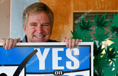"Stock Picture of Rick Steves Travel guide author and marijuana legalization supporter Rick Steves holds a campaign sign in his office in Edmonds, Wash next to a door covered with marijuana leaf-shaped notes from his staff congratulating him on the passage of a referendum legalizing marijuana in the state. In the late-1980s heyday of the ""Just Say No"" campaign, a man calling himself ""Jerry"" appeared on a Seattle radio station's midday talk show, using a pseudonym because he was a businessman, afraid of what his customers would think if they heard him criticizing U.S. marijuana laws. A quarter century later, ""Jerry"" had no problem using his real name - Rick Steves - as one of the main forces behind Washington's successful ballot measure to legalize, regulate and tax marijuana for adults over 21"