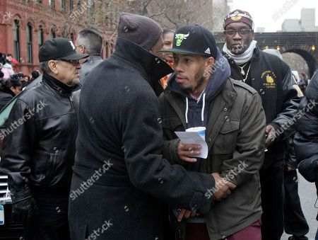 """Hector """"Machito"""" Camacho, Jr Hector """"Machito"""" Camacho, Jr., foreground right, son of Hector """"Macho"""" Camacho, is consoled after the funeral for his father in St. Cecilia's Roman Catholic Church in New York, . Doctors pronounced Camacho dead on Saturday, Nov. 24, after he was removed from life support at his family's direction. He never regained consciousness after at least one gunman crept up to his car in a darkened parking lot in Puerto Rico and opened fire"""