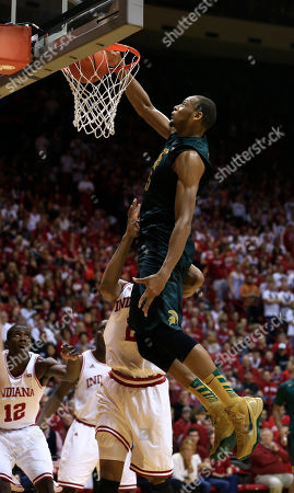 Christian Watford, Adreian Payne Michigan State's Adreian Payne (5) dunks against Indiana's Christian Watford during the first half of an NCAA college basketball game, in Bloomington, Ind