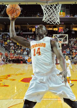 Dewayne Dedmon Southern California's Dewayne Dedmon puts up a shot during the first half of their NCAA basketball game against Minnesota, in Los Angeles