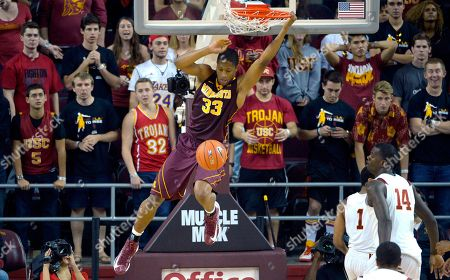 Rodney Williams, Jio Fontan, Dewayne Dedmon Minnesota's Rodney Williams Jr. dunks as Southern California's Jio Fontan (1) and Dewayne Dedmon (14) look on during the second half of their NCAA basketball game, in Los Angeles