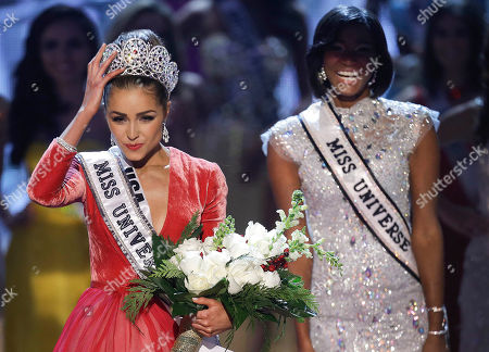 Stock Picture of Olivia Culpo, Leila Lopes Miss USA, Olivia Culpo, left, adjusts her tiara after being crowned the new Miss Universe as Miss Universe 2011, Leila Lopes, of Angola, right, looks, during the Miss Universe competition, in Las Vegas