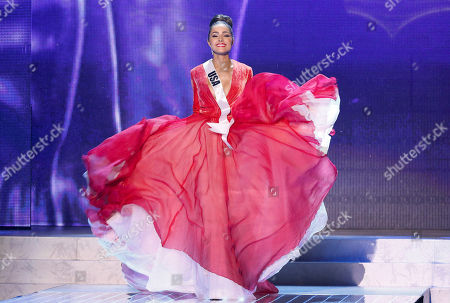 Olivia Culpo Miss USA, Olivia Culpo, walks on stage during a performance by Australian singer Timomatic, during the Miss Universe pageant, in Las Vegas. Culpo was crowned as Miss Universe