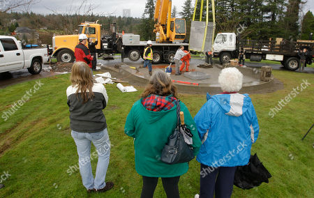 Chuck Cox, Judy Cox From left, Pam Cox, Judy Cox, and Anne Cox, all family members of missing Utah Mom Susan Powell, watch as workers install a memorial to people who have suffered the loss of a child, at Woodbine Cemetery in Puyallup, Wash. The memorial is near where Susan Powell's sons, Charlie and Braden Powell, were buried after their father, Josh Powell, killed them and himself earlier in 2012 during an investigation into the disappearance of Susan Powell. The memorial was paid for with funds donated to Crime Stoppers of Tacoma/Pierce County following the death of the boys