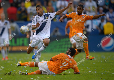 Sean Franklin, Jermaine Taylor, Corey Ashe Los Angeles Galaxy defender Sean Franklin, left, jumps over Houston Dynamo defender Jermaine Taylor along with midfielder Corey Ashe during the second half of their MLS Cup soccer match, in Carson, Calif. The Galaxy won 3-1
