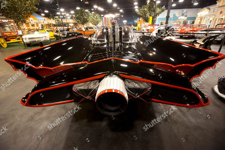 """Batmobile This photo shows the Batmobile sitting in a private auto collection in North Palm Beach, Fla. John Staluppi has spent a lifetime selling cars, so successful in his trade he boasts more than two dozen dealerships and more sales than he ever could count. But even he has never seen a sale like this. Staluppi is liquidating his Cars of Dreams Museum and its 115 collector vehicles in an auction Saturday. The Batmobile, the Evel Knievel motorcycle, the lines and lines of perfectly shined cars, all of them will be gone. """"I'm starting to get sad,"""" he admits"""