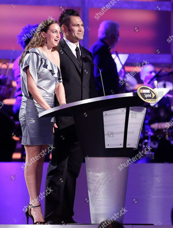 Stock Photo of Rebecca Soni, Johnny Damon Olympic swimmer and silver medalist Rebecca Soni, left, and Major League Baseball player Johnny Damon introduce Clint Bowyer during the season-ending NASCAR awards ceremony, in Las Vegas