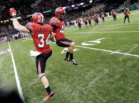 Louisiana-Lafayette kicker Brett Baer (40) celebrates with linebacker Justin Anderson (34) after kicking a field goal against East Carolina to put the game out of reach in second half of the New Orleans Bowl, an NCAA college football game in New Orleans, . Louisiana-Lafayette beat East Carolina 43-34