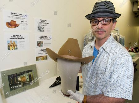 """James Comisar James Comisar shows a Stetson hat worn by actor Larry Hagman portraying oil tycoon J. R. Ewing in the """"Dallas"""" television show. The item is part of his television memorabilia collection in a temperature- and humidity-controlled warehouse in Los Angeles"""