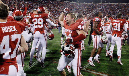 Jayden Bird Oklahoma players celebrate following a 51-48 overtime victory over Oklahoma State in an NCAA college football game in Norman, Okla., . Oklahoma linebacker Jaydan Bird (44) is at center