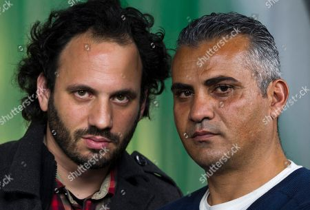 "Guy Davidi, Emad Burnat Documentary film Co-directors, Israeli, Guy Davidi, left, and Palestinian, Emad Burnat, pose for a photo after an interview in Los Angeles. Their 2011 documentary film, ""5 Broken Cameras,"" is nominated for an Oscar in the best Documentary Feature category"