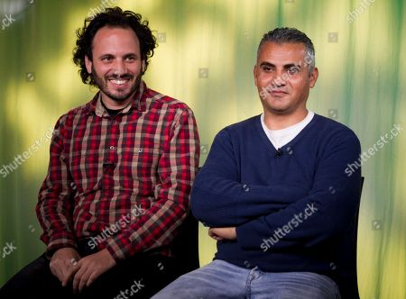 "Stock Image of Guy Davidi, Emad Burnat In this Tues., photo, documentary film Co-directors, Israeli, Guy Davidi, left, and Palestinian, Emad Burnat, pose for a photo after an interview in Los Angeles. Their 2011 documentary film, ""5 Broken Cameras,"" is nominated for an Oscar in the best Documentary Feature category"