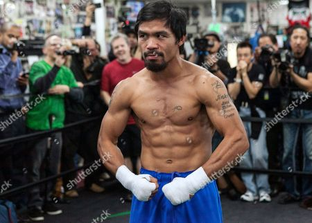Manny Pacquiao Manny Pacquiao poses for photos at the Wild Card Boxing Club in Los Angeles, . Pacquiao is scheduled to fight Juan Marquez in a welterweight boxing match in Las Vegas, Saturday, Dec. 8