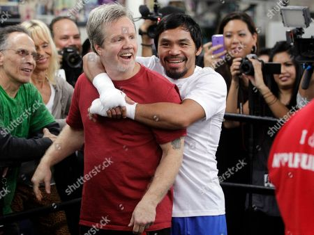 Freddie Roach, Manny Pacquiao Manny Pacquiao, right, hugs trainer Freddie Roach as he poses for photos at the Wild Card Boxing Club in Los Angeles, . Pacquiao is scheduled to fight Juan Marquez in a welterweight boxing match in Las Vegas, Saturday, Dec. 8