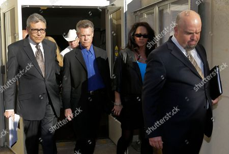 Randy Travis, Larry Friedman Entertainer Randy Travis, second from left, exits Grayson County Courthouse with his lawyer Larry Friedman, left, and an unidentified persons, right, in Sherman, Texas. Travis plead guilty to driving while intoxicated in a plea agreement with the court and will pay a $2,000 fine and serve a two year probation
