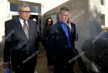 Randy Travis, Larry Friedman Entertainer Randy Travis, right, exits Grayson County Courthouse with attorney Larry Friedman, left, and other members of his legal team, in Sherman, Texas. Travis plead guilty to driving while intoxicated in a plea agreement with the court and will pay a $2,000 fine and serve a two year probation