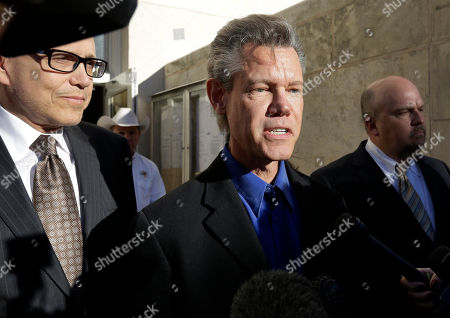 Randy Travis, Larry Friedman Entertainer Randy Travis, center, makes comments after exiting the Grayson County Courthouse with his attorney Larry Friedman, left, and an unidentified person, right, in Sherman, Texas. Travis plead guilty to driving while intoxicated in a plea agreement with the court and will pay a $2,000 fine and serve a two year probation