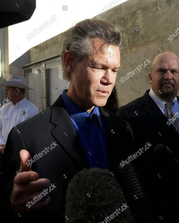 Randy Travis, Larry Friedman Entertainer Randy Travis, center, makes comments after exiting the Grayson County Courthouse with an unidentified person, right, in Sherman, Texas. Travis plead guilty to driving while intoxicated in a plea agreement with the court and will pay a $2,000 fine and serve a two year probation