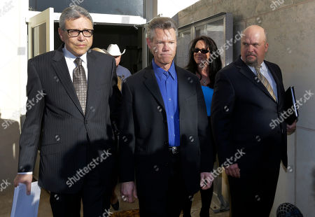 Randy Travis, Larry Friedman Entertainer Randy Travis, center, exits Grayson County Courthouse with his lawyer Larry Friedman, left, and an unidentified persons, right, in Sherman, Texas. Travis plead guilty to driving while intoxicated in a plea agreement with the court and will pay a $2,000 fine and serve a two year probation