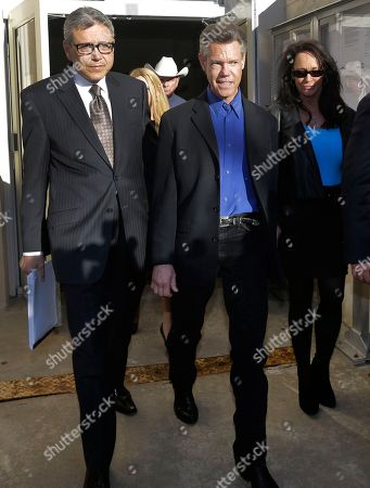 Randy Travis, Larry Friedman Entertainer Randy Travis, center, exits Grayson County Courthouse with his lawyer Larry Friedman, left, and an unidentified person, right, in Sherman, Texas. Travis plead guilty to driving while intoxicated in a plea agreement with the court and will pay a $2,000 fine and serve a two year probation