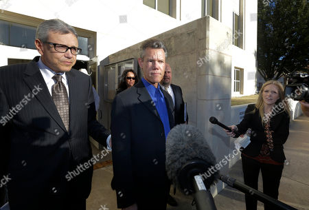 Randy Travis, Larry Friedman Entertainer Randy Travis, center, takes a question from reporters after exiting the Grayson County Courthouse with his lawyer Larry Friedman, left, in Sherman, Texas. Travis plead guilty to driving while intoxicated in a plea agreement with the court and will pay a $2,000 fine and serve a two year probation