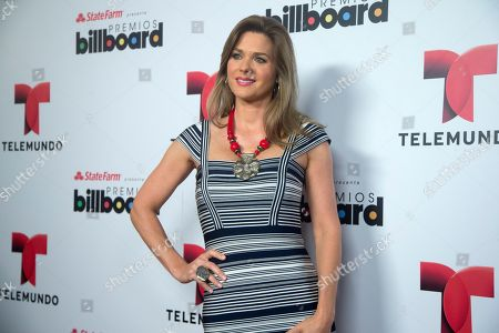 Sonya Smith FOR SIGAL RATNER STORY**Sonya Smith poses for photos after she announced the finalists in Premios Billboard de la Musica Latina 2013 during a tv show in Miami, . Don Omar has done it again. After leading the 2012 list of finalists for the Billboard Latin Music Awards with 16 finalist nods, he returns in 2013 with 18 nods, including Artist of the Year; Social Artist of the Year and Streaming Artist of the Year. Following with 12 nods is bachata star Romeo Santos, while urban duo Wisin & Yandel and the late Jenni Rivera are tied with 11 nods each