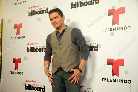 Stock Image of Horacio Palencia Horacio Palencia poses for photos after he announced the finalists in Premios Billboard de la Musica Latina 2013 during a tv show in Miami, . Don Omar has done it again. After leading the 2012 list of finalists for the Billboard Latin Music Awards with 16 finalist nods, he returns in 2013 with 18 nods, including Artist of the Year; Social Artist of the Year and Streaming Artist of the Year. Following with 12 nods is bachata star Romeo Santos, while urban duo Wisin & Yandel and the late Jenni Rivera are tied with 11 nods each
