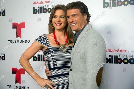 SMITH Sonya Smith, left, and Gabriel Coronel pose for photos after announcing the finalists in Premios Billboard de la Musica Latina 2013 in Miami