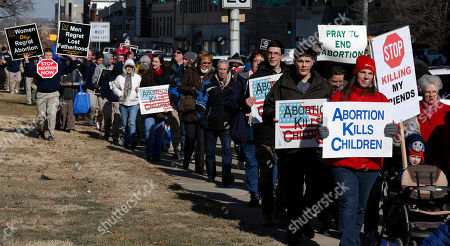 Abortion opponents march to the Kansas Statehouse, and to a rally on the anniversary of Roe v. Wade, in Topeka, Kan., . Gov. Sam Brownback has signed a series of tough, anti-abortion measures during his first two years in office. Much to the dismay of abortion-rights advocates, Kansas has been part of a wave in which states with Republican governors and GOP-controlled Legislatures enacted new restrictions on abortion providers