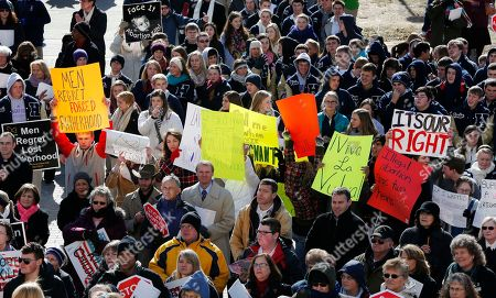 Abortion rights advocates hold signs during a Pro-Life rally on the steps of the Kansas Statehouse in Topeka, Kan., . Both sides met on the 40th anniversary of Roe v. Wade. Gov. Sam Brownback has signed a series of tough, anti-abortion measures during his first two years in office. Much to the dismay of abortion-rights advocates, Kansas has been part of a wave in which states with Republican governors and GOP-controlled Legislatures enacted new restrictions on abortion providers