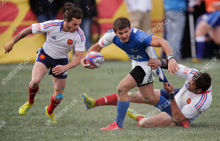 Agustin Migliore, Jean Baptiste Gobelet Argentina's Agustin Migliore, center, is pulled down by France's Jean Baptiste Gobelet, right, as France's Terry Bouhraoua helps defend during the Bowl Final of the Sevens Rugby World Series tournament, in Las Vegas. France won 17-12