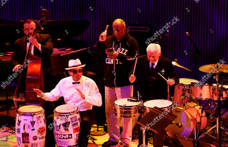 Bill Cosby, Pete Escovedo, John Santos Bill Cosby, second from right, plays with Pete Escovedo, right, and John Santos, second from left, during the opening night concert of the SFJAZZ Center in San Francisco. The 700-seat, specially designed concert hall nestled in the heart of the city's arts district attracted a crowd of hundreds with a high-energy, inaugural celebration emceed by Bill Cosby. Billed as the first freestanding building in the West built for jazz performance and education, the center opened Wednesday after raising more than $60 million over more than a decade to build a home for SFJAZZ, the nonprofit that puts on the city's jazz festival