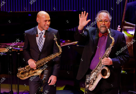 Joshua Redman, Joe Lovano Saxophonists Joshua Redman, left, and Joe Lovano, right, perform during the opening night concert of the SFJAZZ Center in San Francisco. The 700-seat, specially designed concert hall nestled in the heart of the city's arts district attracted a crowd of hundreds with a high-energy, inaugural celebration emceed by Bill Cosby. Billed as the first freestanding building in the West built for jazz performance and education, the center opened Wednesday after raising more than $60 million over more than a decade to build a home for SFJAZZ, the nonprofit that puts on the city's jazz festival