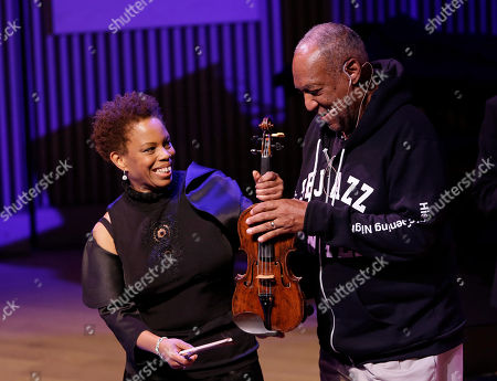 Bill Cosby, Regina Carter Bill Cosby, right, jokes with Regina Carter about her violin during the opening night concert of the SFJAZZ Center in San Francisco. The 700-seat, specially designed concert hall nestled in the heart of the city's arts district attracted a crowd of hundreds with a high-energy, inaugural celebration emceed by Bill Cosby. Billed as the first freestanding building in the West built for jazz performance and education, the center opened Wednesday after raising more than $60 million over more than a decade to build a home for SFJAZZ, the nonprofit that puts on the city's jazz festival