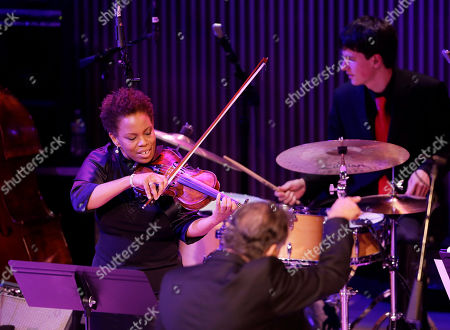 Stock Picture of Regina Carter Violinist Regina Carter performs during the opening night concert of the SFJAZZ Center in San Francisco. The 700-seat, specially designed concert hall nestled in the heart of the city's arts district attracted a crowd of hundreds with a high-energy, inaugural celebration emceed by Bill Cosby. Billed as the first freestanding building in the West built for jazz performance and education, the center opened Wednesday after raising more than $60 million over more than a decade to build a home for SFJAZZ, the nonprofit that puts on the city's jazz festival