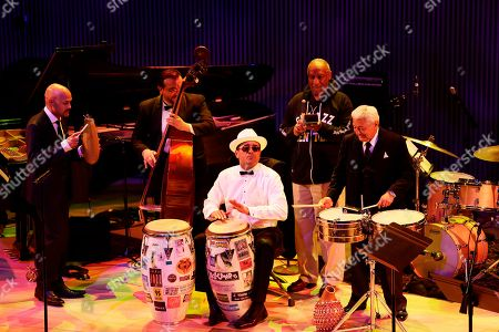 """Miguel Zenon, Matt Penman, John Santos, Bill Cosby, Pete Escovedo From left, Miguel Zenon, Matt Penman, John Santos, Bill Cosby with a cowbell and Pete Escovedo play """"Ti Mon Bo"""" during the opening night concert of the SFJAZZ Center in San Francisco. The 700-seat, specially designed concert hall nestled in the heart of the city's arts district attracted a crowd of hundreds with a high-energy, inaugural celebration emceed by Bill Cosby. Billed as the first freestanding building in the West built for jazz performance and education, the center opened Wednesday after raising more than $60 million over more than a decade to build a home for SFJAZZ, the nonprofit that puts on the city's jazz festival"""