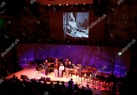 Bill Cosby, Pete Escovedo, John Santos Bill Cosby, second from right, plays with Pete Escovedo, right, and John Santos, third from left, during the opening night concert of the SFJAZZ Center in San Francisco. The 700-seat, specially designed concert hall nestled in the heart of the city's arts district attracted a crowd of hundreds with a high-energy, inaugural celebration emceed by Bill Cosby. Billed as the first freestanding building in the West built for jazz performance and education, the center opened Wednesday after raising more than $60 million over more than a decade to build a home for SFJAZZ, the nonprofit that puts on the city's jazz festival
