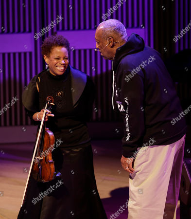 Regina Carter, Bill Cosby Bill Cosby, right, laughs with violinist Regina Carter, left, during the opening night concert of the SFJAZZ Center in San Francisco. The 700-seat, specially designed concert hall nestled in the heart of the city's arts district attracted a crowd of hundreds with a high-energy, inaugural celebration emceed by Bill Cosby. Billed as the first freestanding building in the West built for jazz performance and education, the center opened Wednesday after raising more than $60 million over more than a decade to build a home for SFJAZZ, the nonprofit that puts on the city's jazz festival